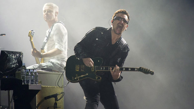 Bono, right, and Adam Clayton, perform in concert as part of U2's 360 Tour on July 20. Davis Guggenheim's documentary about the band is to open the Toronto International Film Festival.