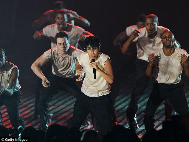 Lady Gaga stuns the audience at the MTV Video Music Awards by performing dressed as a man