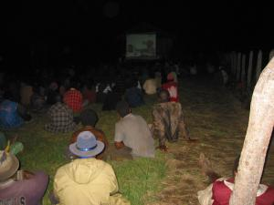 Villagers in Papua New Guinea watching an HIV prevention film