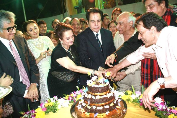 Legendary actor Dilip Kumar cutting birthday cake
