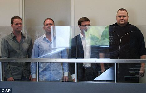 Megaupload workers Bram van der Kolk, left, Finn Batato, second from left, Mathias Ortmann and founder, former CEO and current chief innovation officer Kim Dotcom, right, appear in North Shore District Court in Auckland, New Zealand