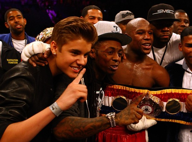 Singer Justin Bieber, Rapper Lil Wayne, boxer Floyd Mayweather Jr., rapper Curtis '50 Cent' Jackson and guest pose after Mayweather Jr. defeats Miguel Cotto.