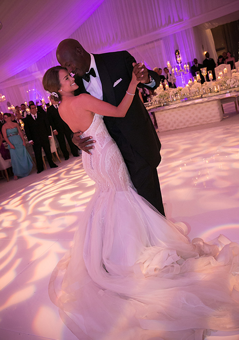 Michael Jordan and Yvette Prieto dance together after their marriage ceremony on April 27, 2013 in Palm Beach Florida.