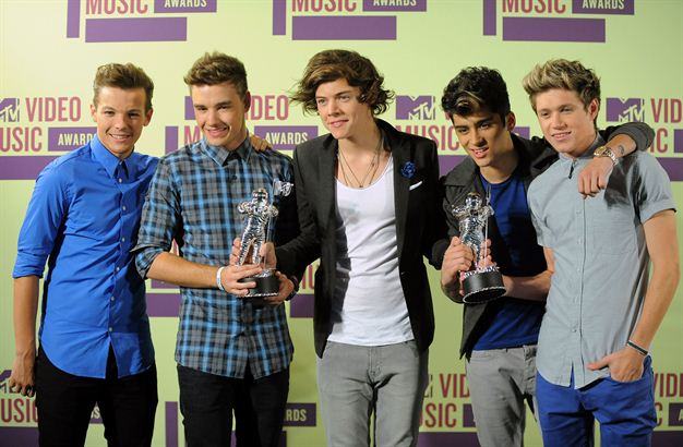 Members of the British band One Direction, from left, Louis Tomlinson, Liam Payne, Harry Styles, Zayn Malik and Niall Horan pose backstage with their awards at the MTV Video Music Awards on Thursday, Sept. 6, 2012, in Los Angeles.