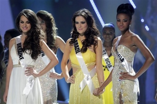The top three finalists at the Miss Universe pageant, Miss Ukraine Olesia Stefanko, left, Miss Brazil Priscila Machado, center, and Miss Angola Leila Lopes wait for the final announcements during the pageant